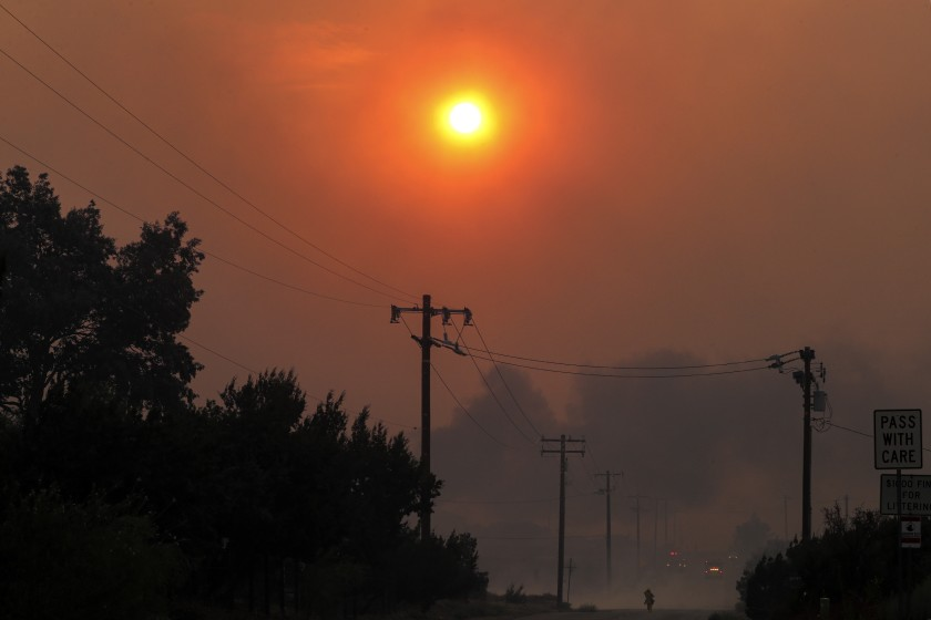 Heavy smoke from the Bobcat fire, seen from Cima Mesa Road in Juniper Hills blocks the sun on Sept. 18, 2020. (Irfan Khan / Los Angeles Times)