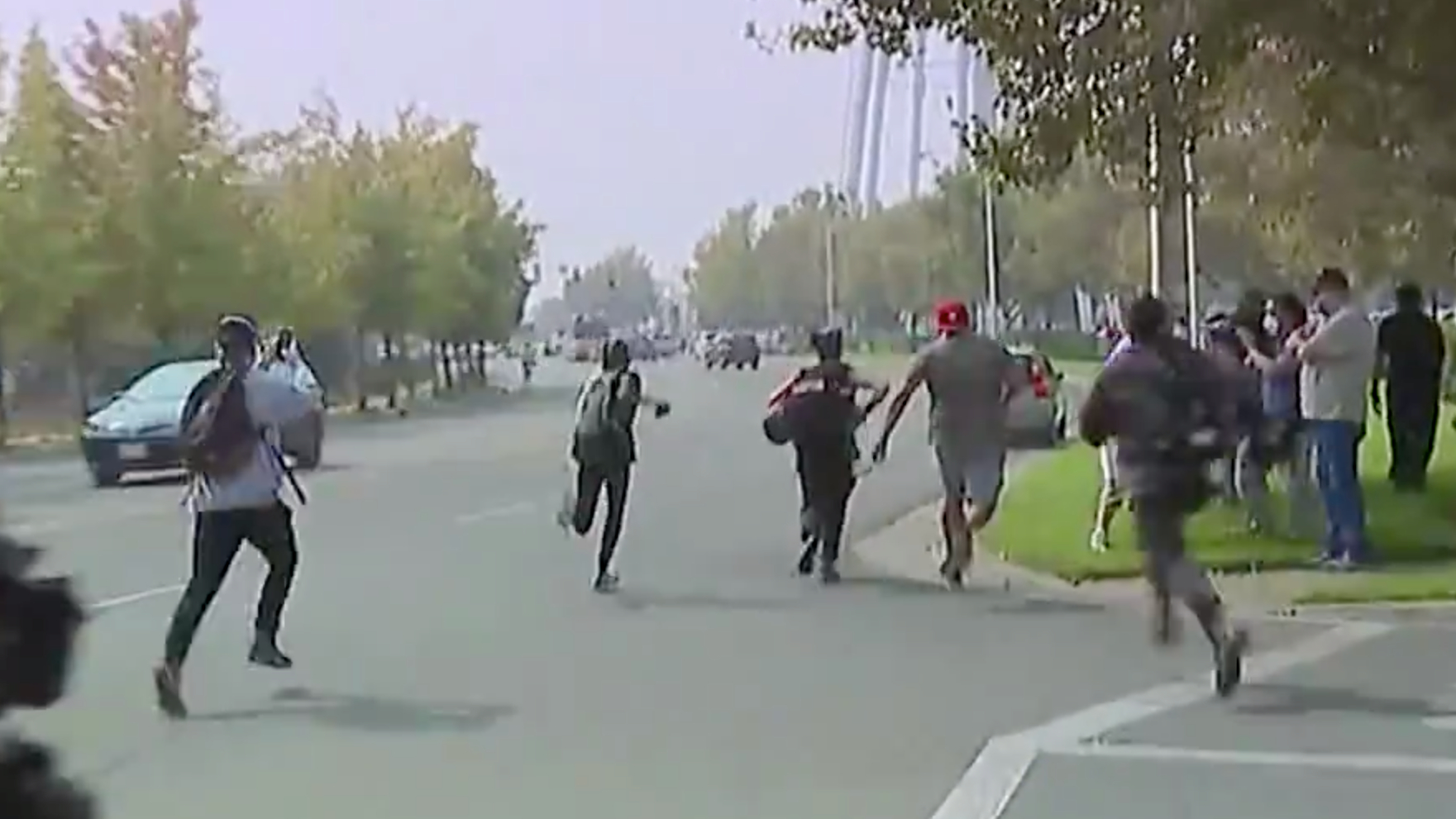 Protesters chase after a car after it swerved into a group of people near McClellan Air Force Base during a visit from President Donald Trump on Sept. 14, 2020. (KTXL)