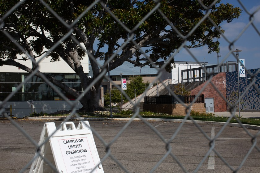 """A sign reads """"campus on limited operations"""" at L.A. City College in 2020. (Gabriella Angotti-Jones / Los Angeles Times)"""