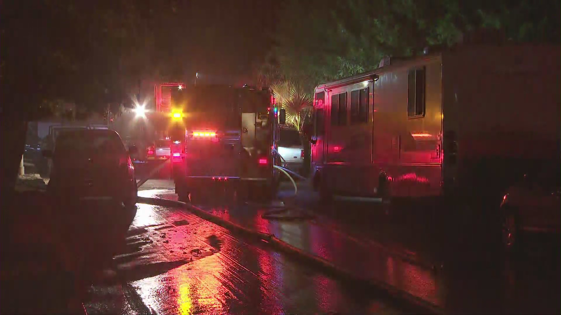 Firefighters respond to a deadly house fire 11538 Kismet Avenue in Lake View Terrace on Sept. 27, 2020. (KTLA)