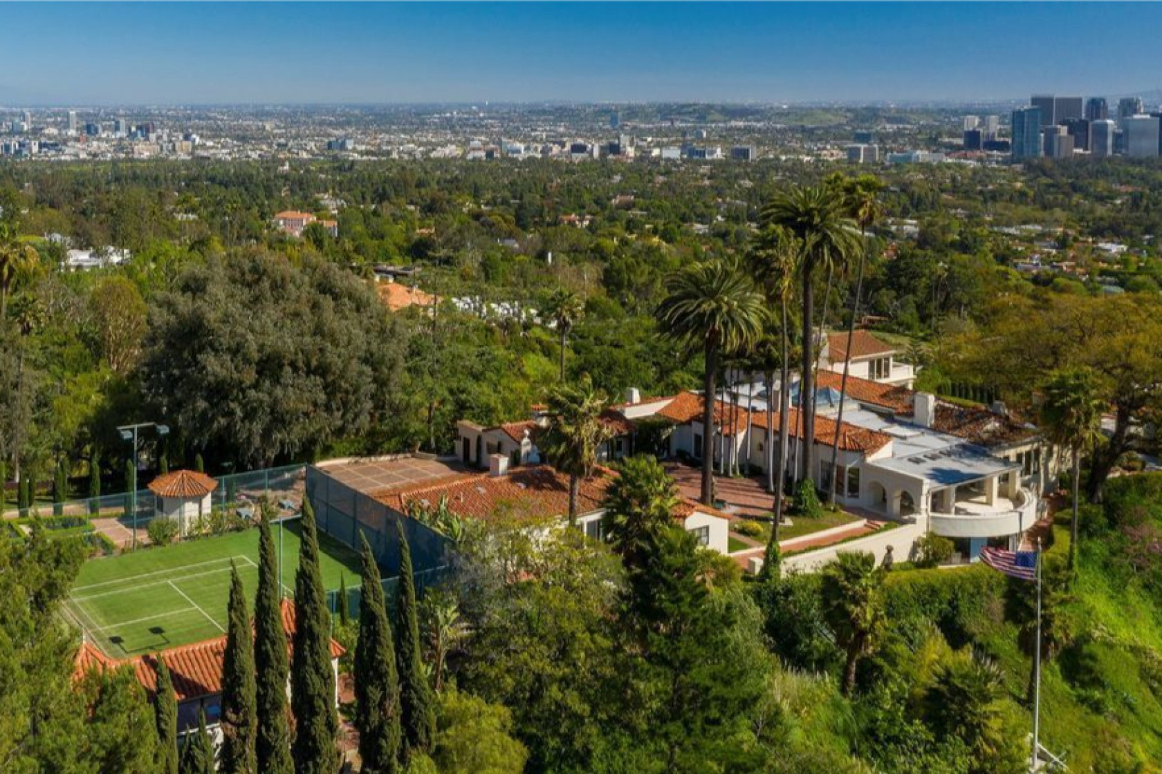 The 2.5-acre site includes a 1930s home, two guesthouses, a screening room, swimming pool and tennis court. (Realtor.com via Los Angeles Times)