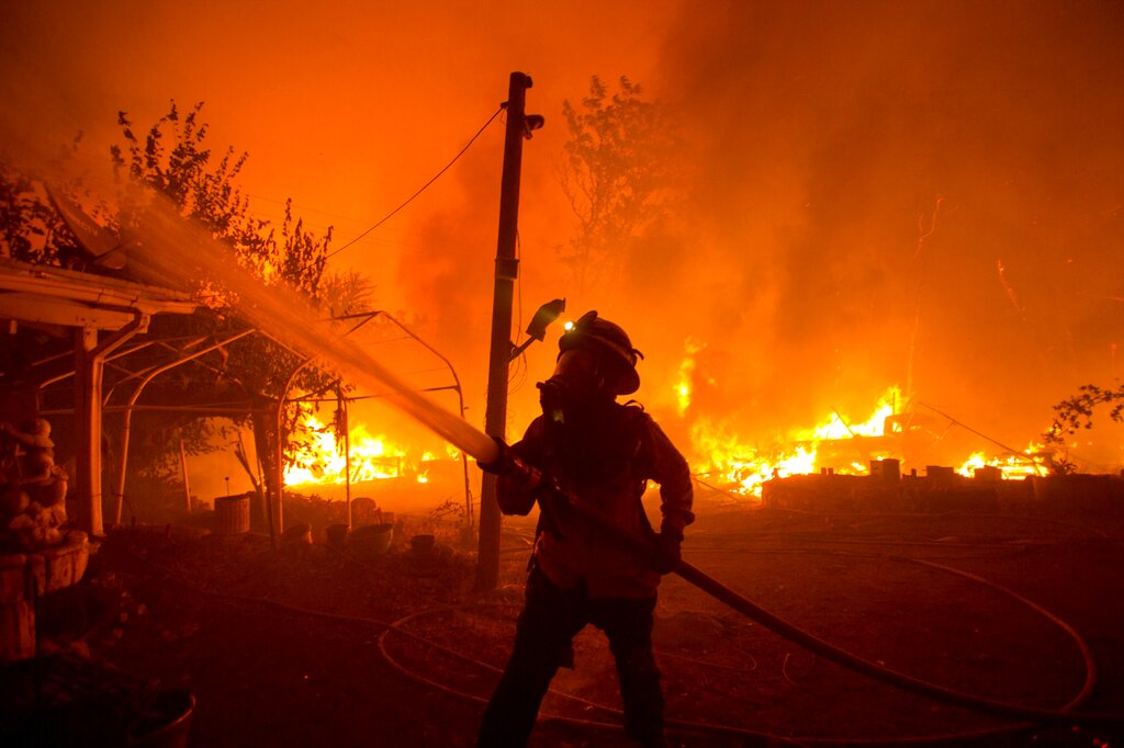 A firefighter works against the Lake Hughes Fire in Angeles National Forest north of Santa Clarita, Calif. (AP Photo/Ringo H.W. Chiu, File)