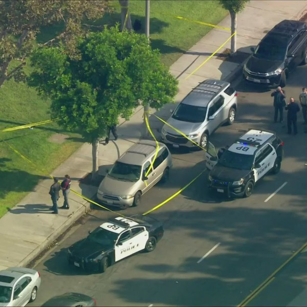 A brown minivan is seen parked in front of the Kaiser Permanente Baldwin Park Medical Center on Sept. 2, 2020. (KTLA)