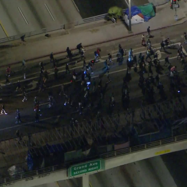 Protesters march across a freeway overpass in downtown Los Angeles on Sept. 23, 2020, following a grand jury's decision not to charge Louisville police officers directly in Breonna Taylor's death. (KTLA)
