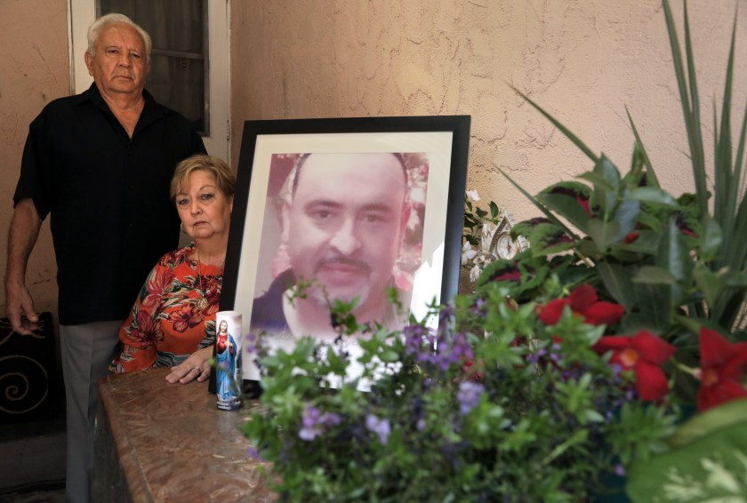 Juan and Blanca Briceno created a shrine for their son Eric Briceno, who was killed by deputies in March during what they said was a mental health call. They pose for a portrait in this undated photo. (Myung J. Chun / Los Angeles Times)