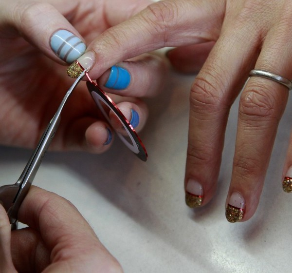 A nail technician works on a customer's nails in this undated file photo. (Kirk McKoy / Los Angeles Times)