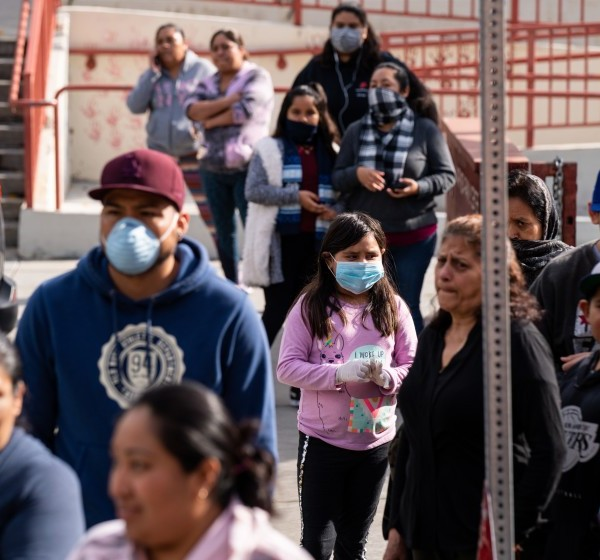 Families wait in line in April at the Mar Vista Family Center for free food and headphones in this undated photo. (Kent Nishimura / Los Angeles Times)