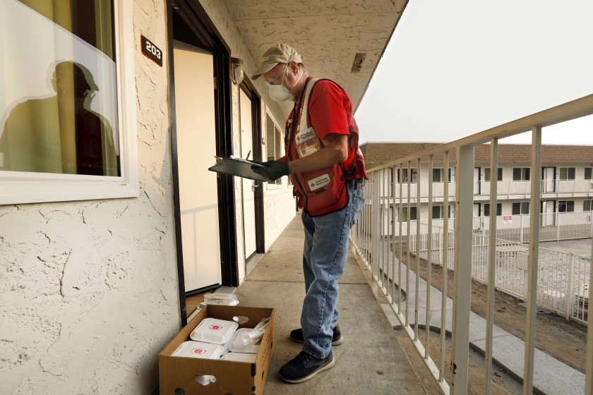 Red Cross volunteer James Wood delivers meals to wildfire evacuees at a Motel 6 in Oroville, Calif. in this undated photo. (Carolyn Cole/Los Angeles Times)