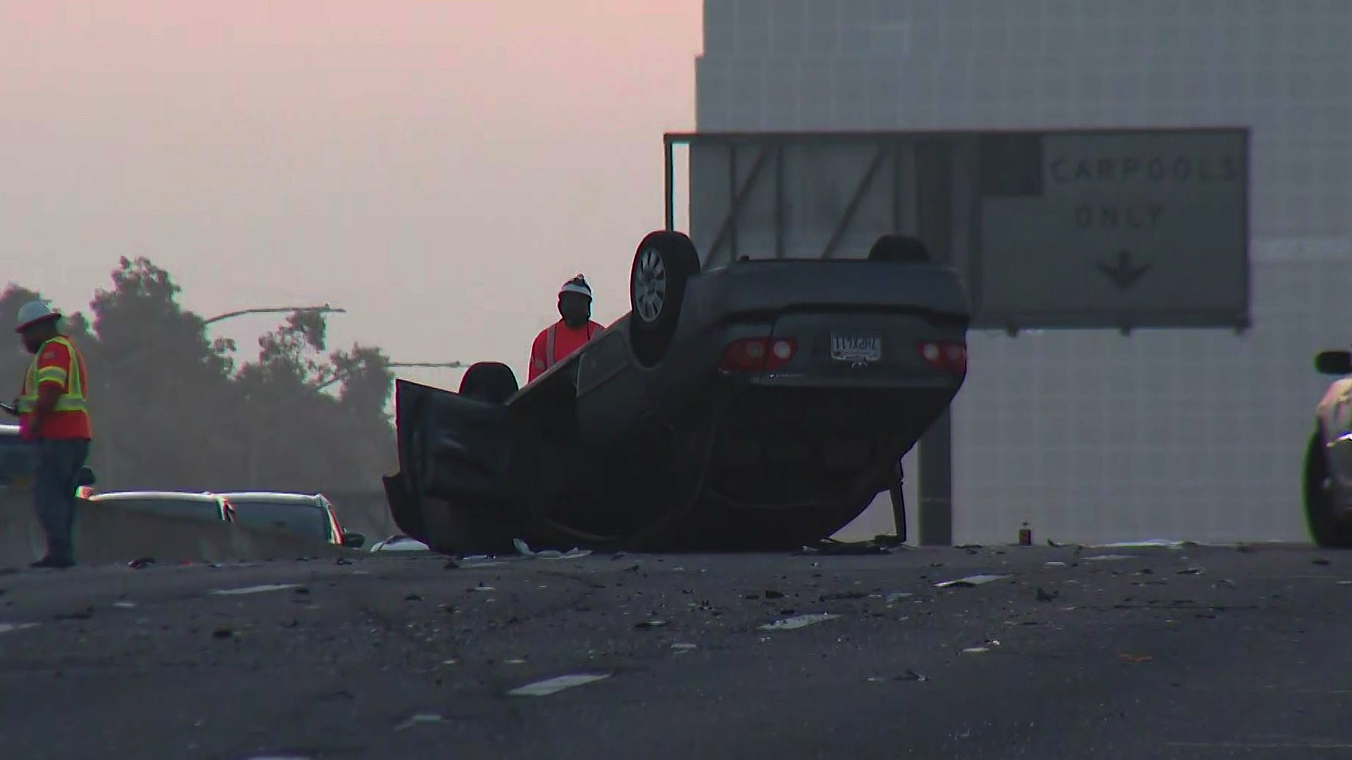 Crews respond to a fatal crash on the 405 Freeway in the Harbor Gateway area on Sept. 24, 2020. (KTLA)