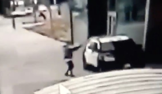 A person appears to fire into a Los Angeles County Sheriff's Department patrol vehicle in a still from footage released by the department on Sept. 12, 2020. Officials said the shooting occurred in Compton that same day.