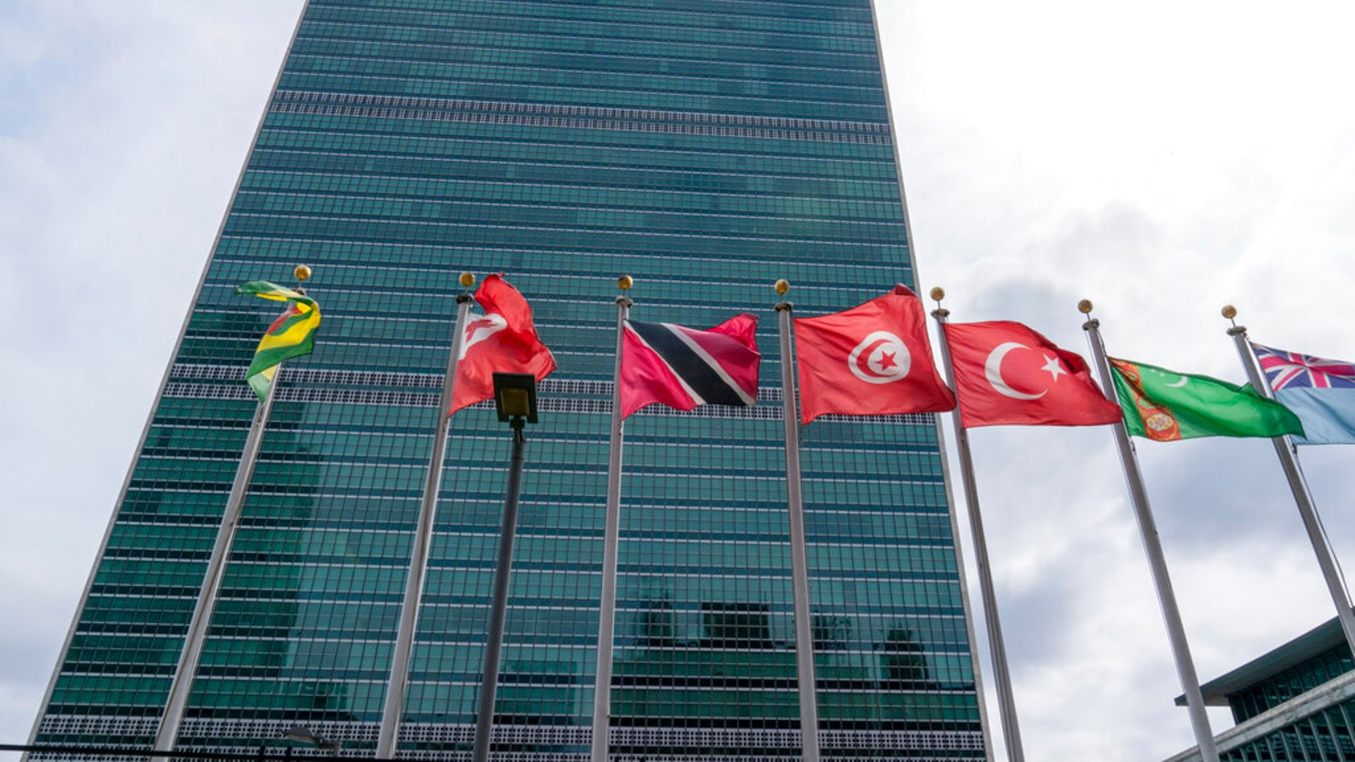 Member state flags fly outside the United Nations headquarters, Friday, Sept. 18, 2020, in New York. (AP Photo/Mary Altaffer)