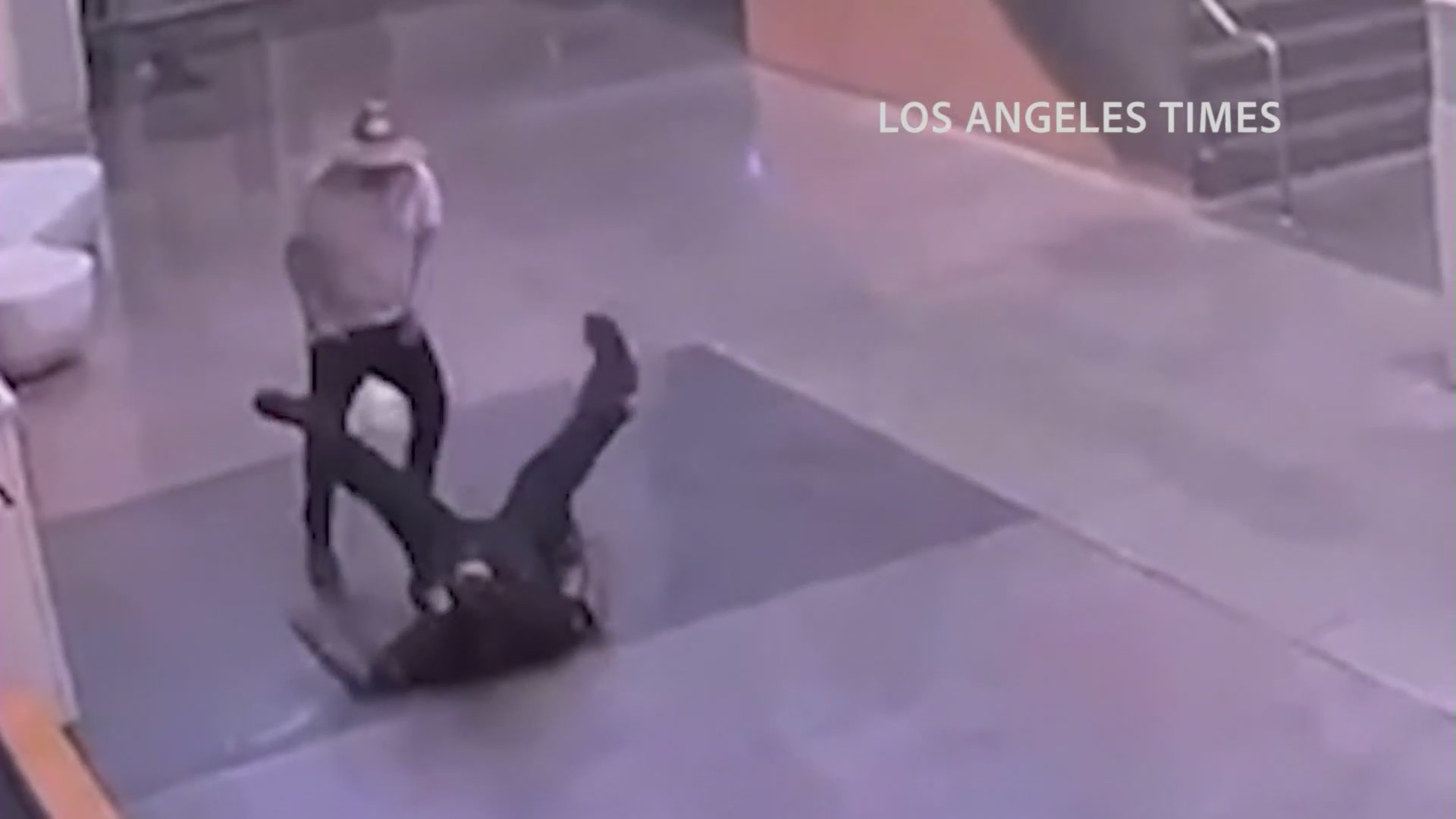 A screenshot from a security video obtained by The Los Angeles Times shows Jose Cerpa Guzman attacking LAPD officer at the Harbor Station in San Pedro on Sept. 26, 2020.