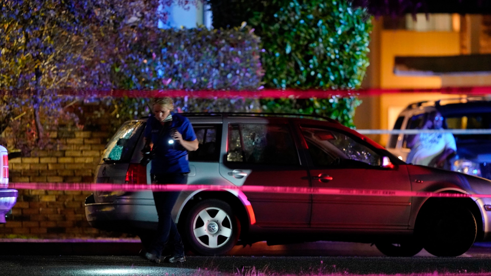 An investigator works at a scene where a man suspected of fatally shooting a supporter of a right-wing group in Portland, Ore., last week was killed as investigators moved in to arrest him in Lacey, Wash., Thursday, Sept. 3, 2020. (AP Photo/Ted Warren)