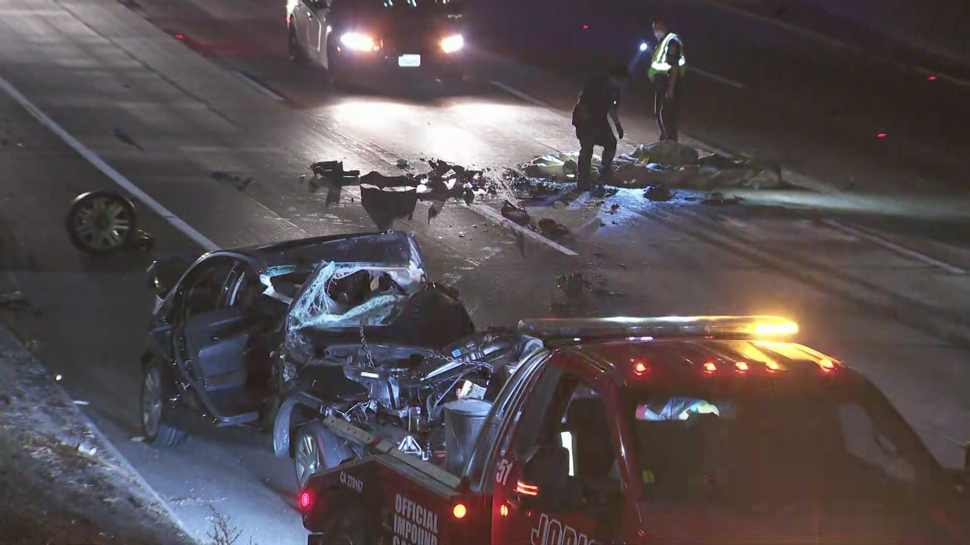 Crews work to clear the 101 Freeway in Hollywood after a fatal crash on Oct. 8, 2020. (KTLA)