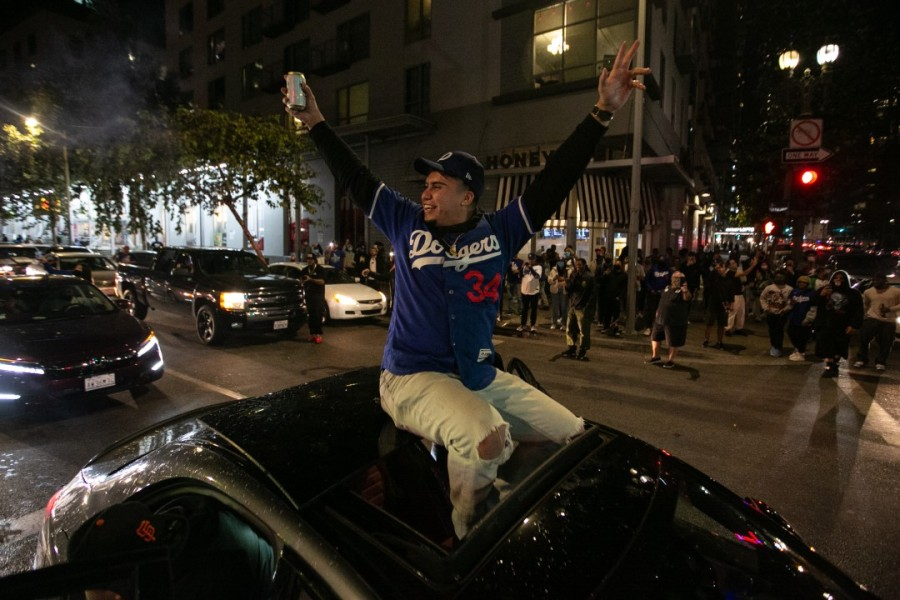 Fans celebrate after the Los Angeles Dodgers defeated the Tampa Bay Rays on Oct. 27, 2020 to win their first World Series since 1988. (Jason Armond / Los Angeles Times)