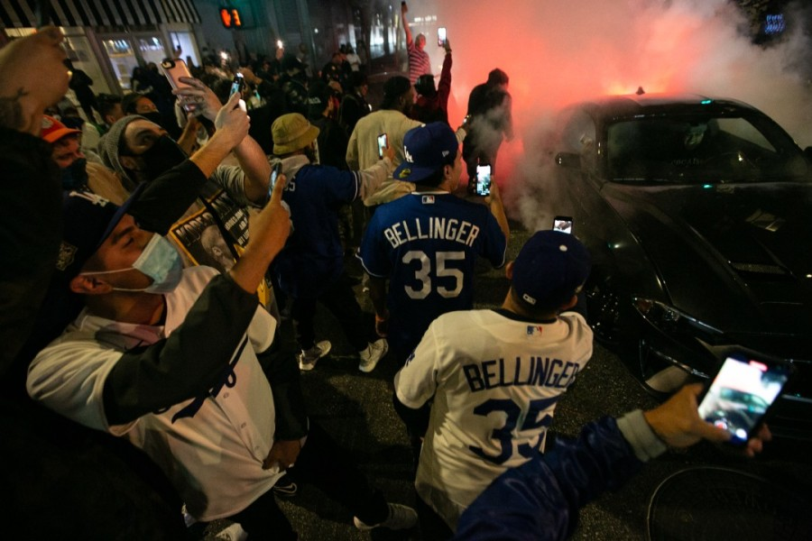 Fans gather in downtown Los Angeles on Oct. 27, 2020 to celebrate the Los Angeles Dodgers win over the Tampa Bay Rays in Game 6 to win the World Series.(Jason Armond / Los Angeles Times)