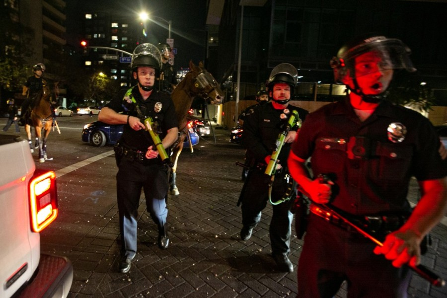 Police disperse crowds in downtown Los Angeles celebrating the Dodgers winning the World Series on Oct. 27, 2020. (Jason Armond / Los Angeles Times)