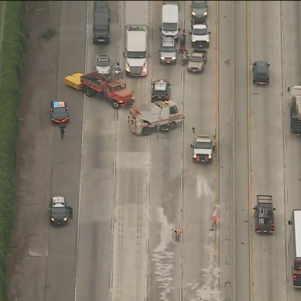 A crash on the 5 Freeway shutdown the southbound lanes in Downey on Oct. 9, 2020. (KTLA)