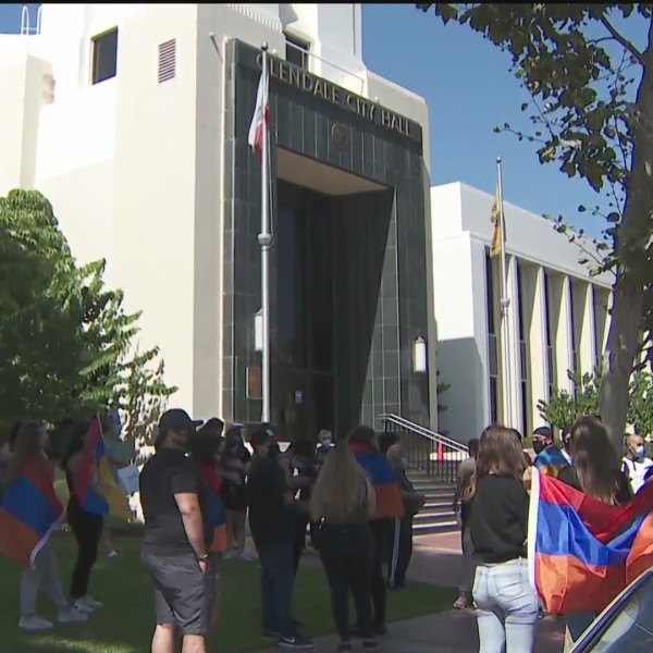 People with Armenian flags gather outside Glendale City Hall on Oct. 3, 2020. (KTLA)