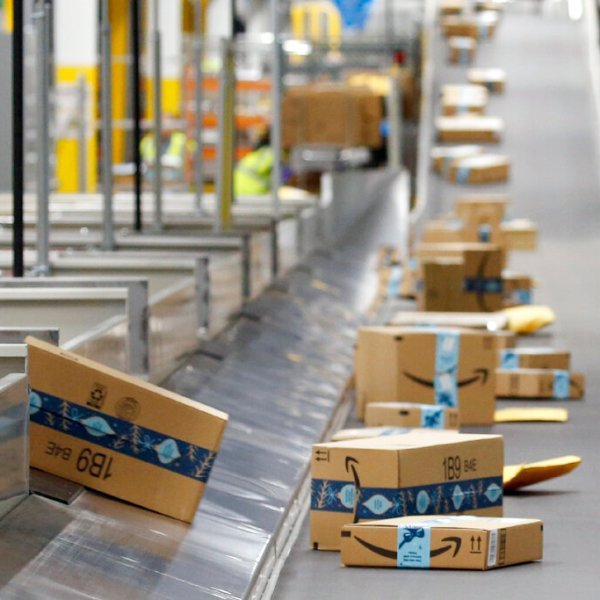 In this Dec. 17, 2019, file photo, Amazon packages move along a conveyor at an Amazon warehouse facility in Goodyear, Ariz. (AP Photo/Ross D. Franklin, File)