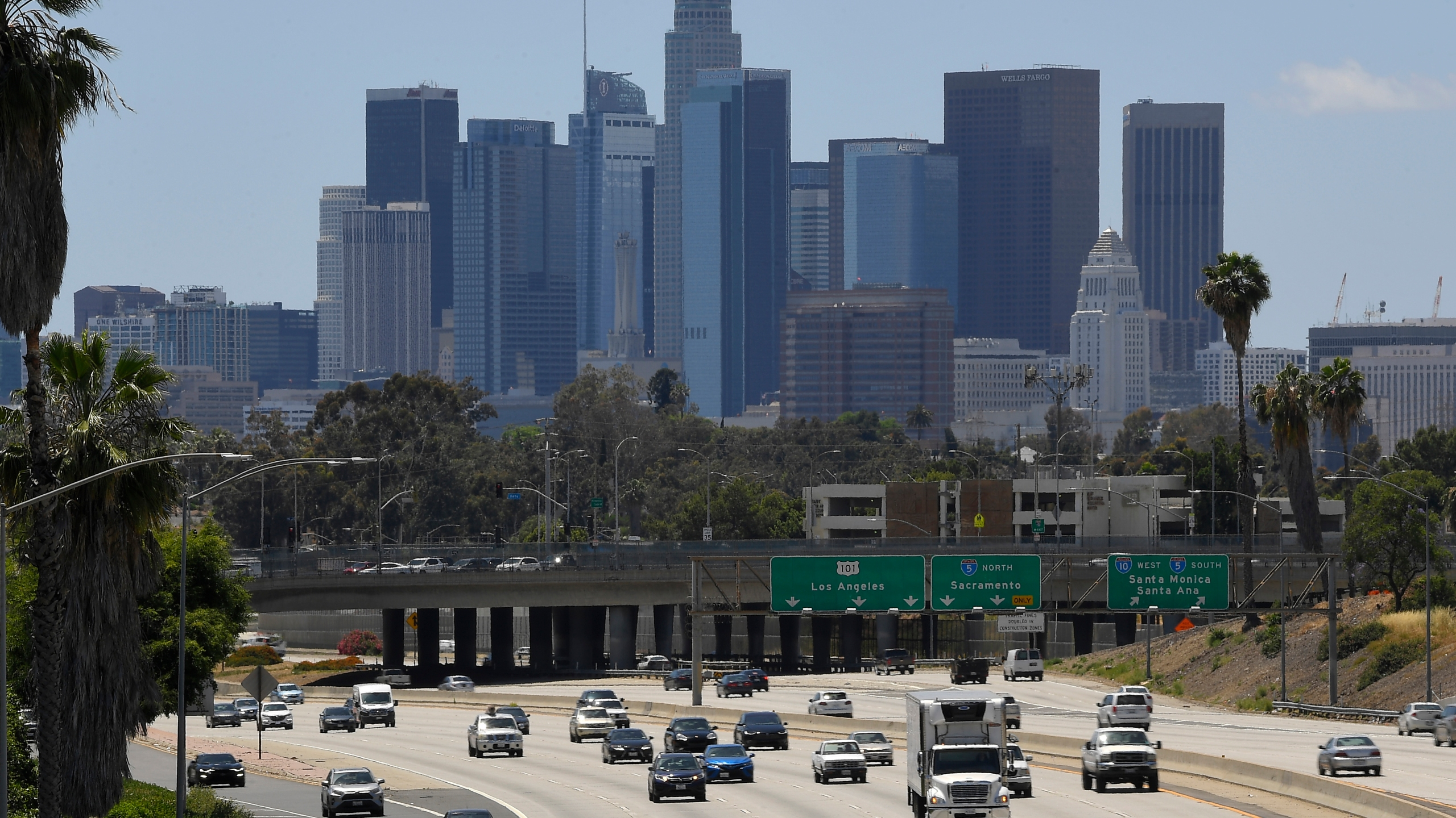 Traffic moves along the 10 Freeway as downtown Los Angeles is seen in the background in Los Angeles on May 19, 2020. (AP Photo/Mark J. Terrill)