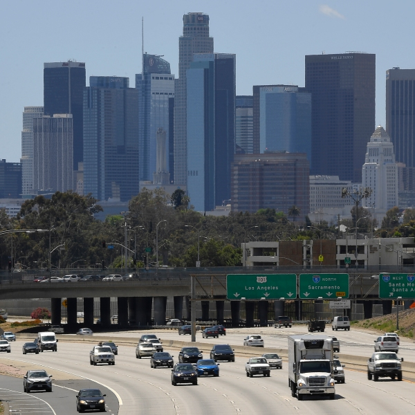Traffic moves along the 10 Freeway as downtown Los Angeles is seen in the background in Los Angeles on May 19, 2020. California voters on the November ballot will decide whether to raise property taxes on commercial and industrial land to raise up to an estimated $12 billion annually for public schools and city halls across the state. (AP Photo/Mark J. Terrill,File)