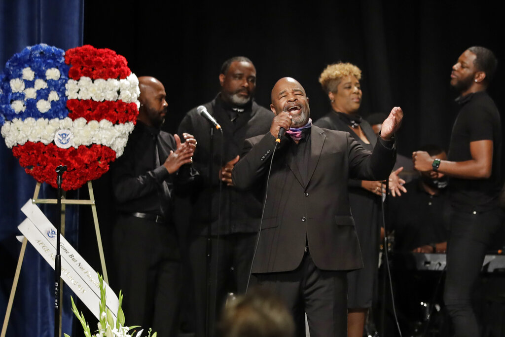 Minister Marvin Webb sings during a memorial service for Federal Protective Services Officer Dave Patrick Underwood on June 19, 2020, in Pinole, Calif. Underwood was fatally shot as he was guarding the Ronald V. Dellums Federal Building in Oakland, Calif., amid protests on May 29. (AP Photo/Ben Margot)