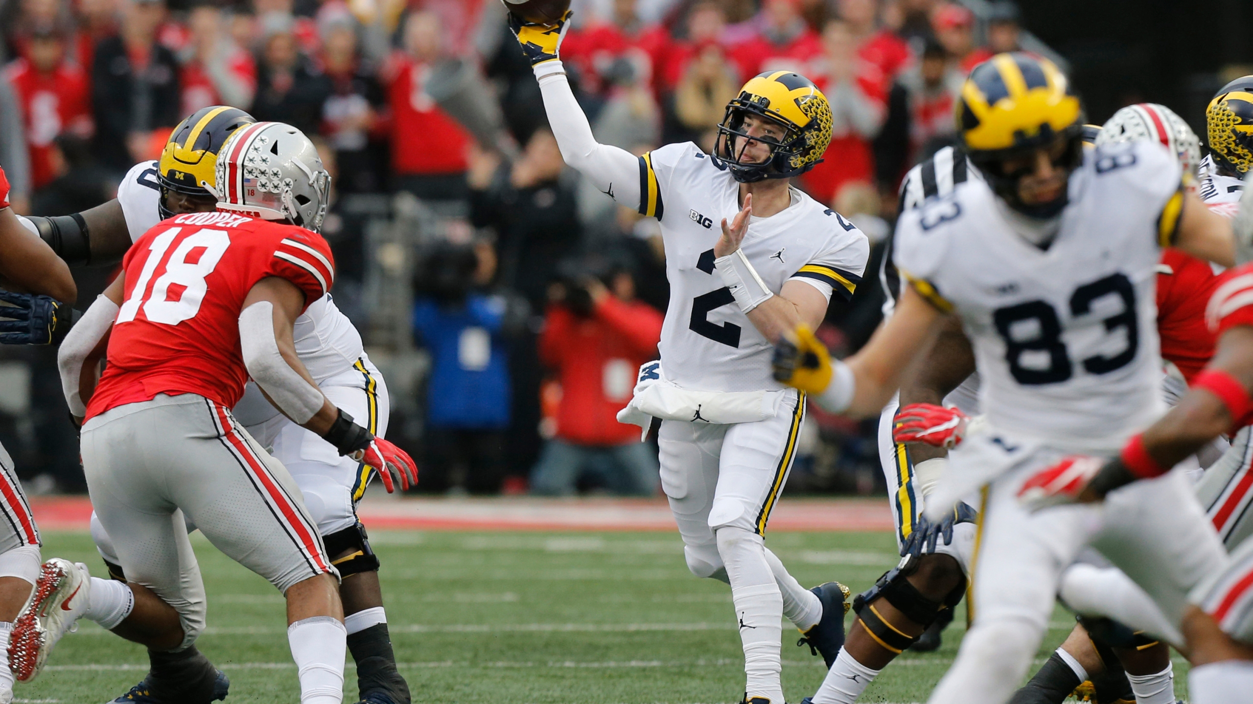 "In this Nov. 24, 2018, file photo, Michigan quarterback Shea Patterson throws a pass against Ohio State during an NCAA college football game in Columbus, Ohio. Magistrate Judge Norah McCann King moved a change of plea hearing from June 18 to July 1, 2020, for Daniel Rippy. Rippy is accused of making an ""electronic communication"" threat from California during this game between Ohio State and the University of Michigan threatening a shooting and vowing to hurt players on the football team. (AP Photo/Jay LaPrete)"