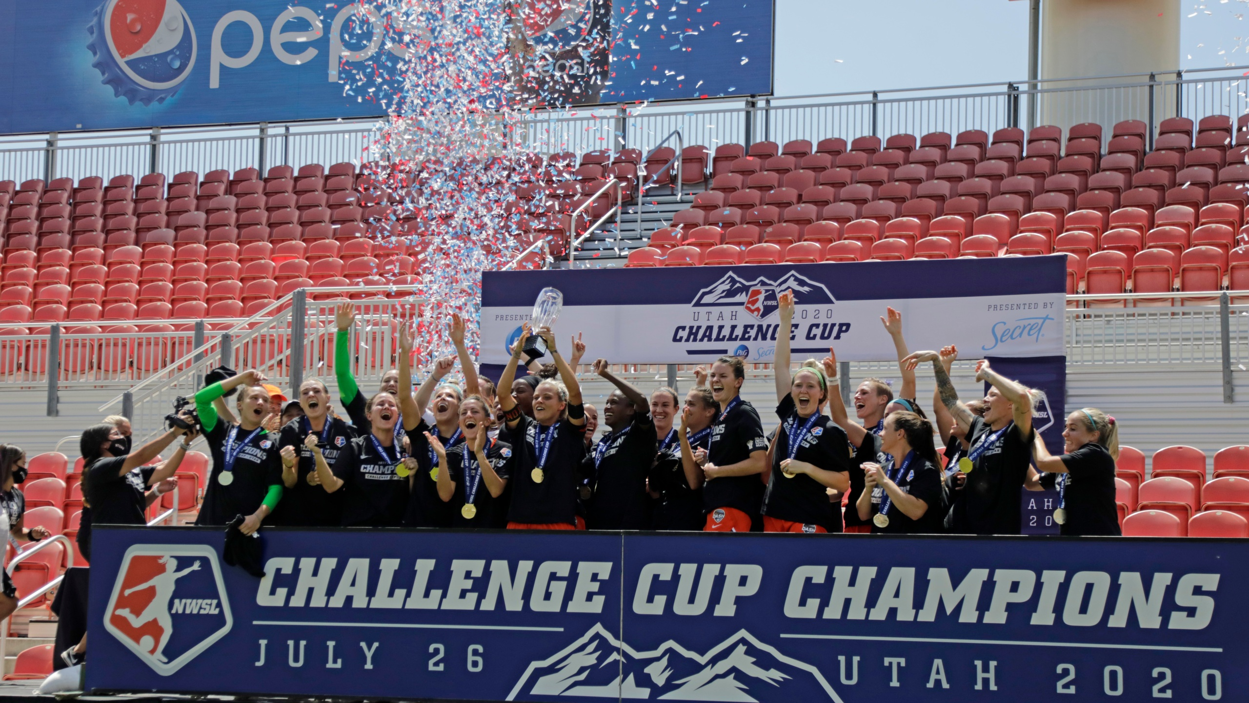 Houston Dash's Rachel Daly hoists the trophy with teammates after defeating the Chicago Red Stars to win the championship soccer game of the NWSL Challenge Cup Sunday, July 26, 2020, in Sandy, Utah. The Angel City Football Club will begin NWSL play in 2022. (AP Photo/Rick Bowmer)