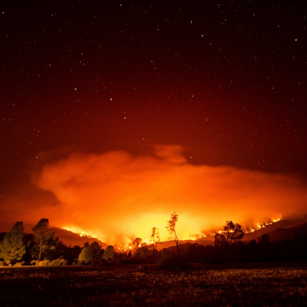 The August Complex Fire burns near Lake Pillsbury in the Mendocino National Forest, Calif., on Wednesday, Sept. 16, 2020. (AP Photo/Noah Berger)