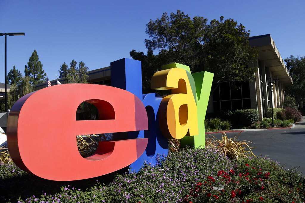In this Oct. 17, 2012, file photo, an eBay sign sits in front of the company's headquarters in San Jose, Calif. AP Photo/Marcio Jose Sanchez, File)