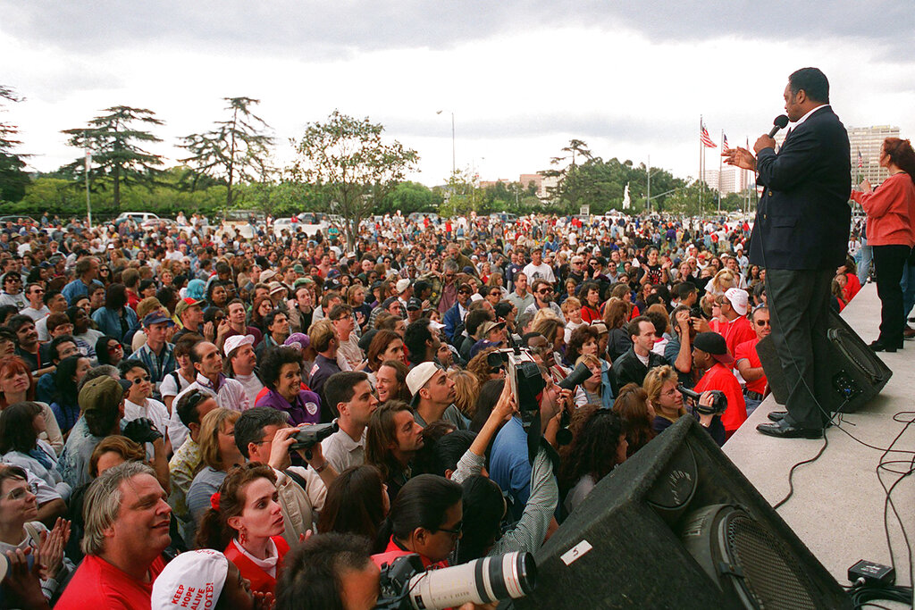 In this Oct. 27, 1996 file photo, the Rev. Jesse Jackson asks a crowd for donations to the advertising fund to stop Proposition 209 during a rally in the Westwood section of Los Angeles. Jackson was at the rally to speak out against the proposition, which he said would hurt women and people of color. In November 2020, a California with vastly different political preferences and demographics will consider repealing a 1996 law barring state and local governments from discriminating against or granting preferential treatment to people based on race, ethnicity, national origin or sex. (AP Photo/Rene Macura, File)