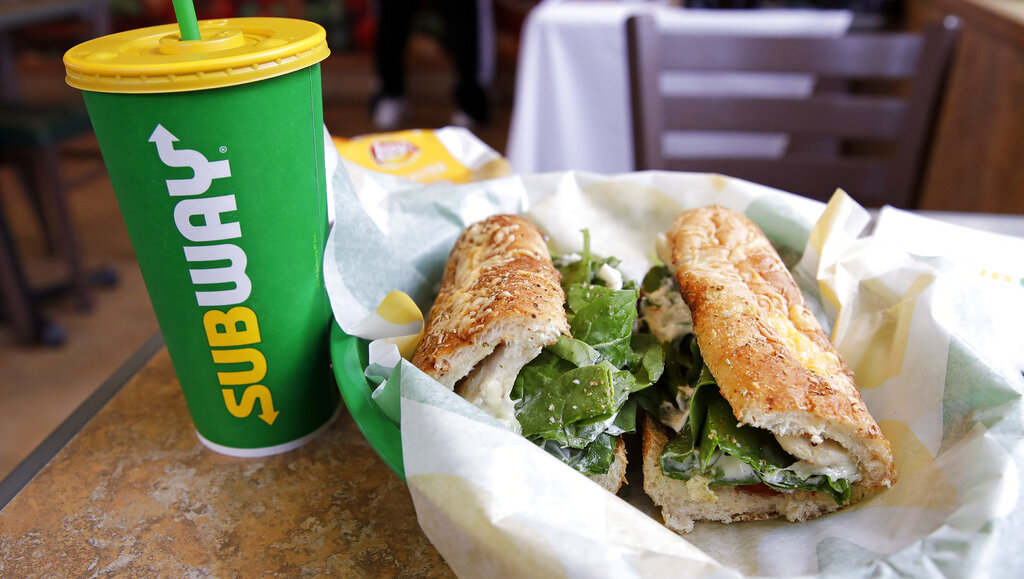 In this Feb. 23, 2018 file photo, a sandwich and a Subway soft drink cup are seen at a restaurant in Londonderry. (AP Photo/Charles Krupa, File)