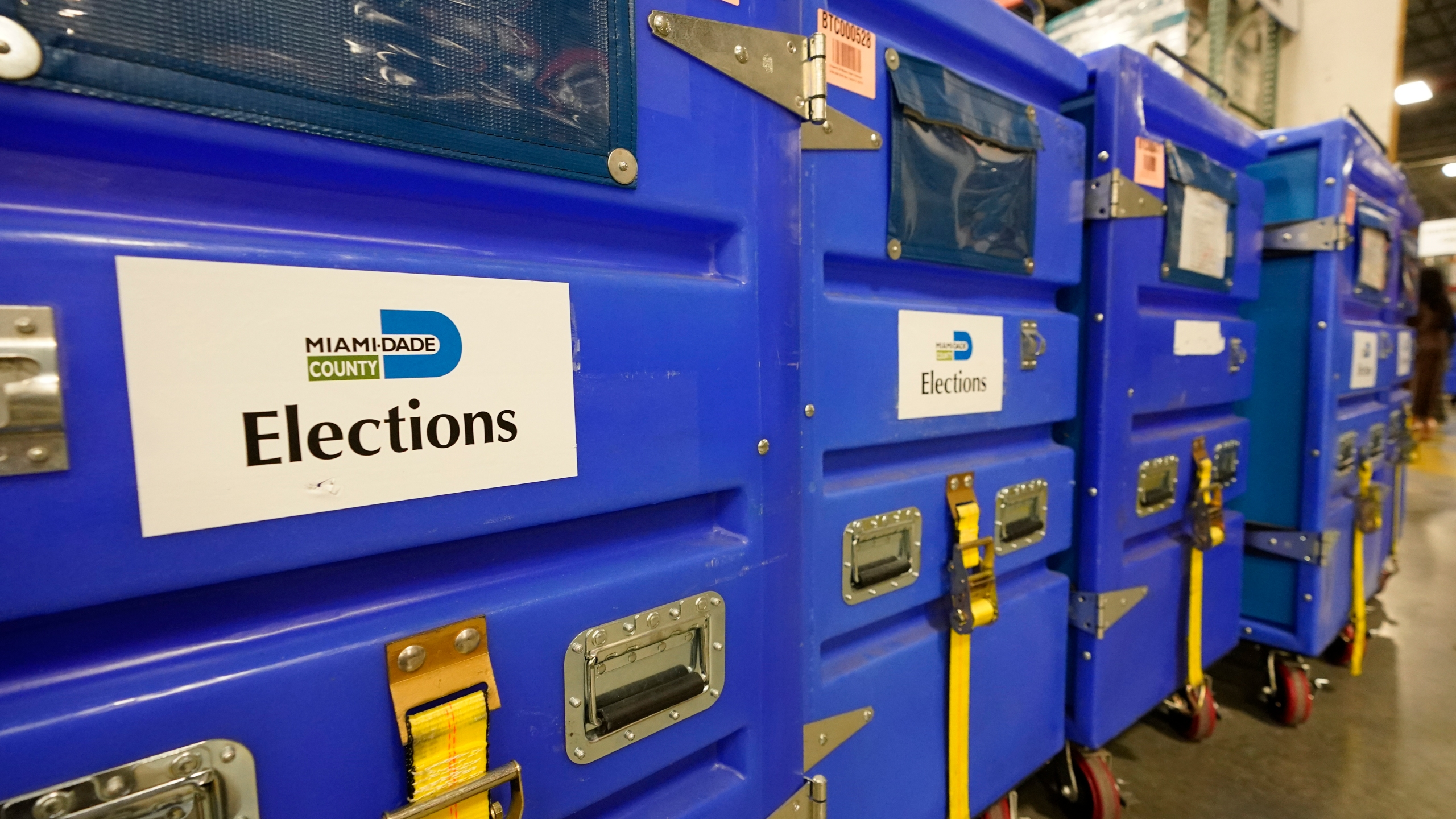 Crates loaded with election supplies are seen at the Miami-Dade County Elections Department, Thursday, Oct. 1, 2020, in Doral, Fla. (AP Photo/Wilfredo Lee)