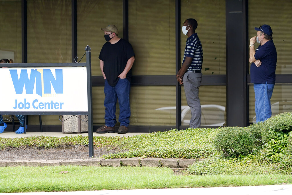 In this Aug. 31, 2020, file photo, clients line up outside the Mississippi Department of Employment Security WIN Job Center in Pearl, Miss. (AP Photo/Rogelio V. Solis, File)