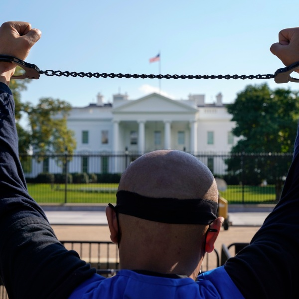 A member of the Uyghur American Association rallies in front of the White House on Oct. 1, 2020, after marching from Capitol Hill in Washington, in support of the Uyghur Forced Labor Prevention Act which has passed the House and now will go on to the Senate. (AP Photo/Jacquelyn Martin)