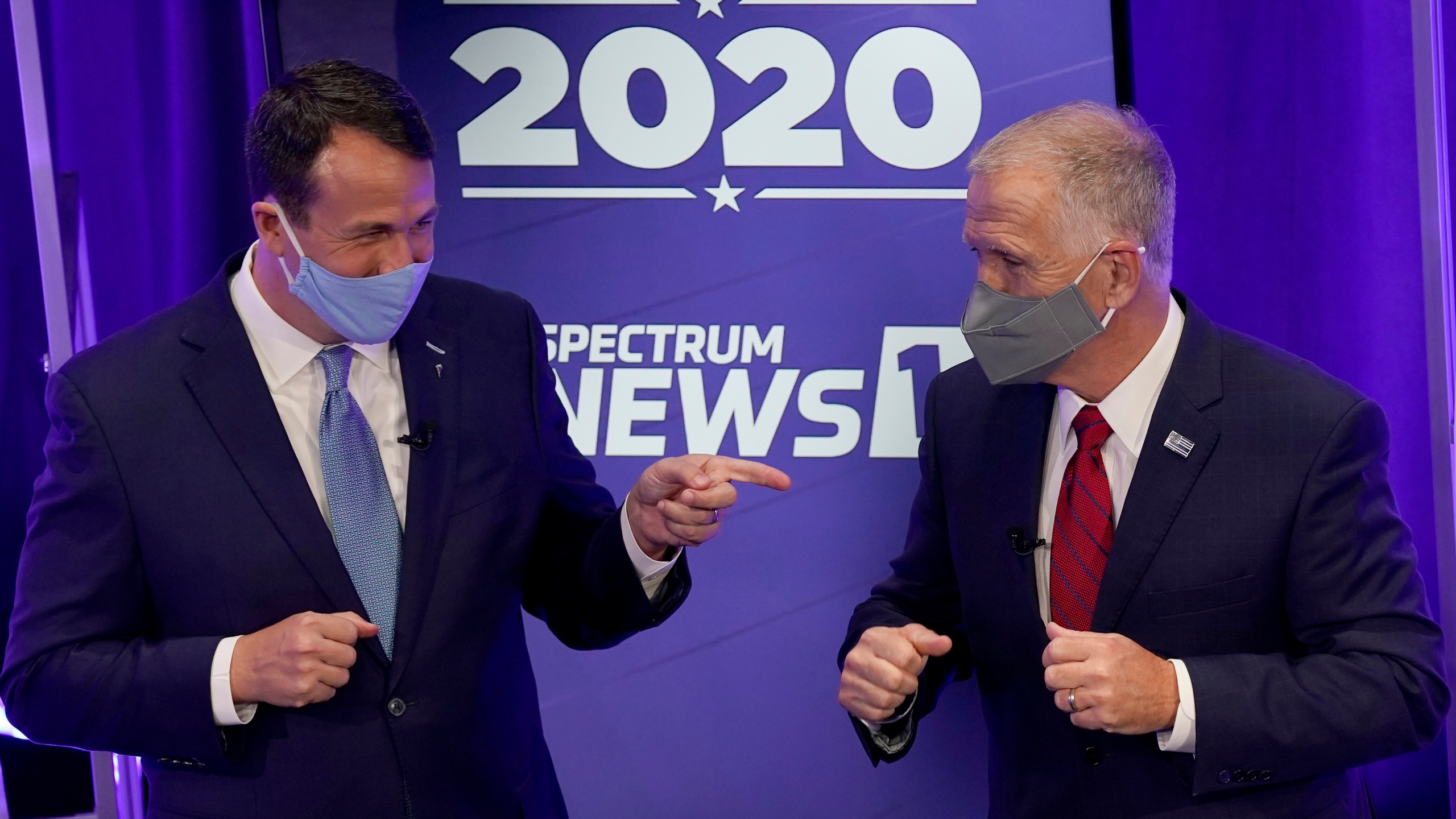 Democratic challenger Cal Cunningham, left, and U.S. Sen. Thom Tillis, R-N.C. greet each other after a televised debate Thursday, Oct. 1, 2020 in Raleigh, N.C. (AP Photo/Gerry Broome, Pool)