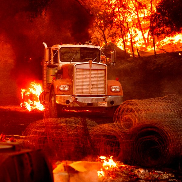 Flames from the Glass Fire burn a truck in a Calistoga vineyard on Oct. 1, 2020. (AP Photo/Noah Berger)