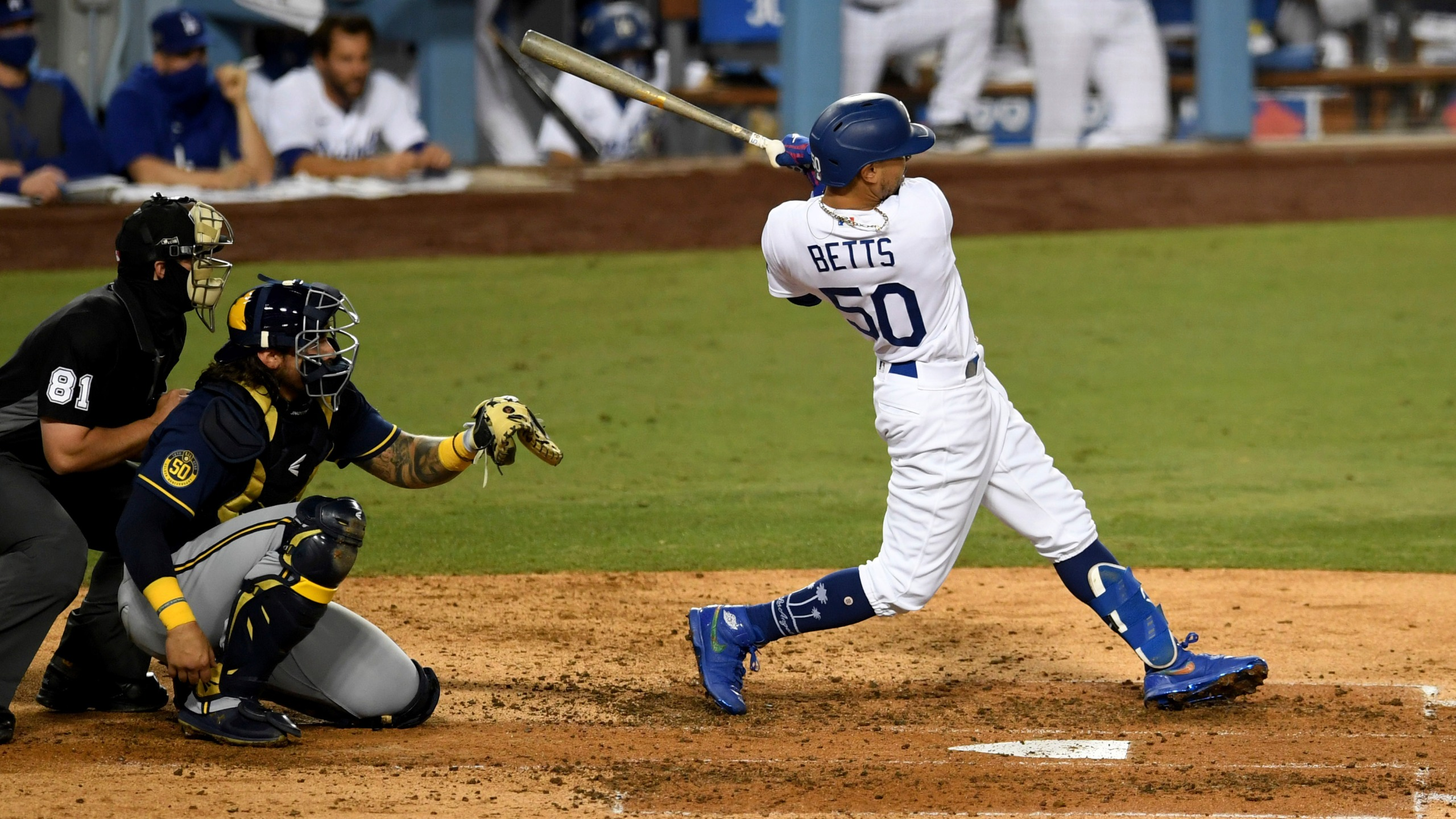 Mookie Betts #50 of the Los Angeles Dodgers two RBI double against the Milwaukee Brewers in the fifth inning of Game 2 of a National League wild-card baseball series MLB baseball game at Dodger Stadium in Los Angeles on Oct. 1, 2020. (Keith Birmingham/The Orange County Register via AP)