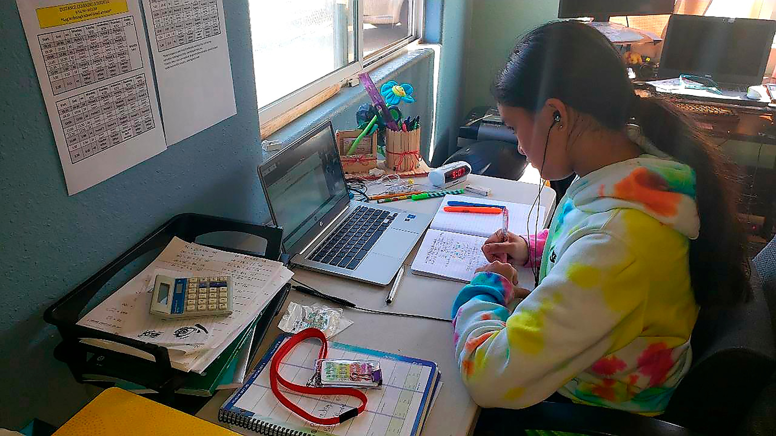 This photo provided by Charles Timtim shows his daughter doing schoolwork from home in Waipahu, Hawaii on Sept. 22, 2020. (Charles Timtim via AP)