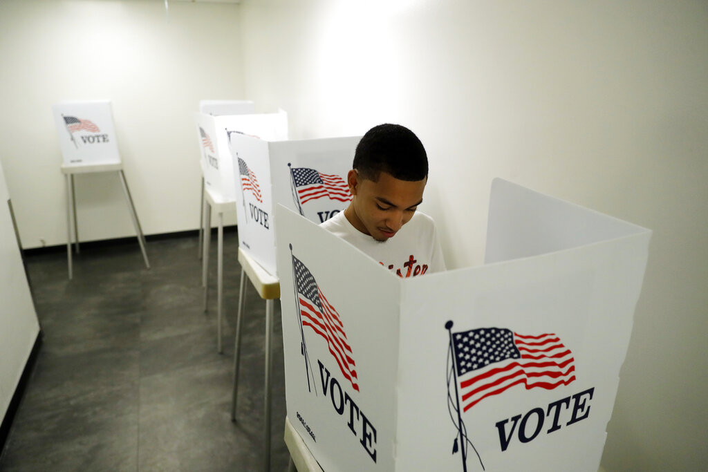 In this Oct. 23, 2018 file photo, Christian Goodman, 18, votes for the first time in his life at the Los Angeles County Registrar of Voters office Tuesday, Oct. 23, 2018, in Norwalk, Calif. (AP Photo/Marcio Jose Sanchez, File)