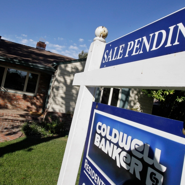 In this Aug. 21, 2012, file photo, the exterior of a house with a pending home sale sign is viewed in Palo Alto. (AP Photo/Paul Sakuma, File)