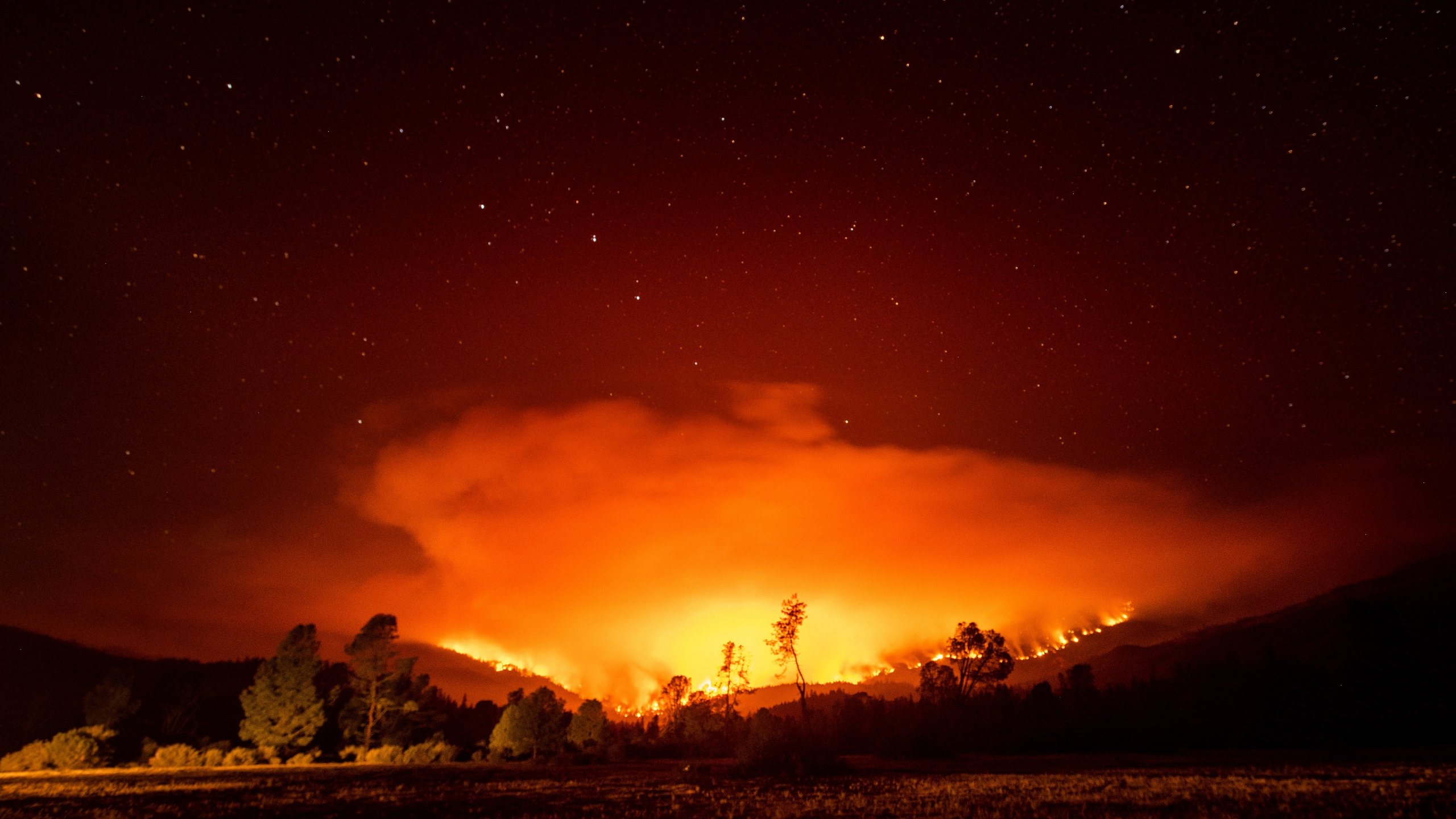 In this Sept. 16, 2020 file photo, the August Complex Fire burns near Lake Pillsbury in the Mendocino National Forest. (Noah Berger/Associated Press)