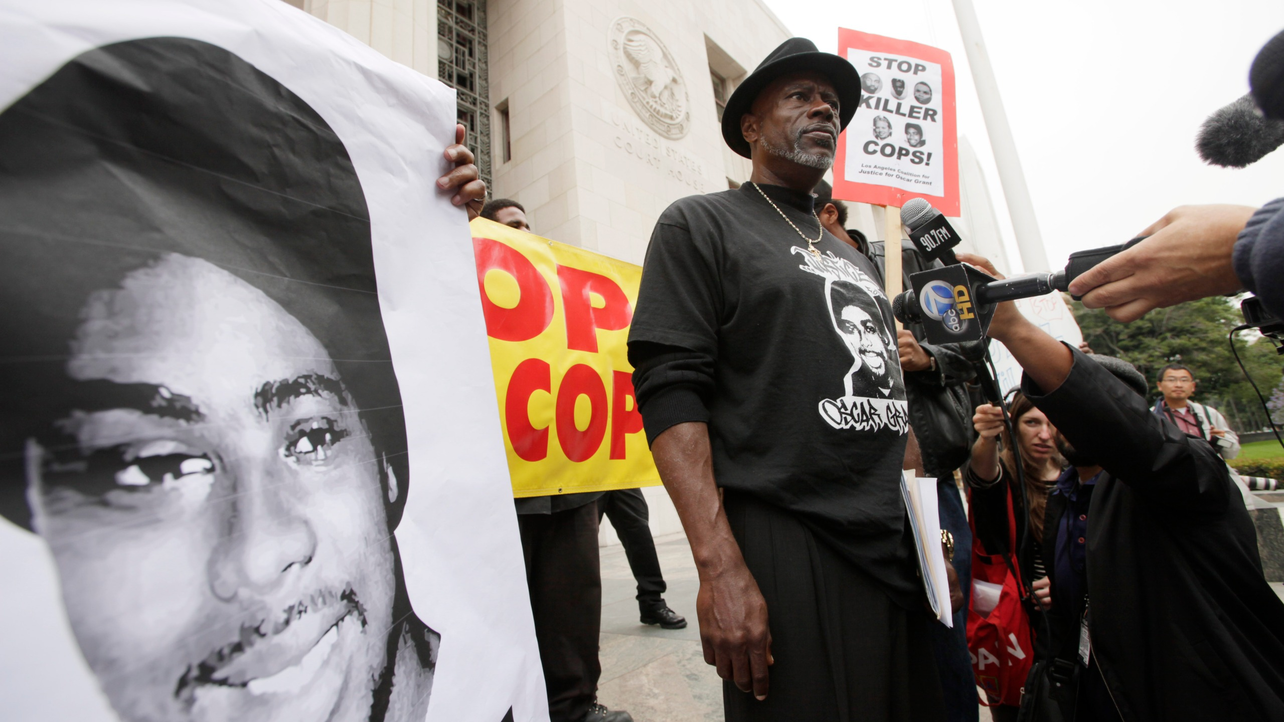 "In this June 13, 2011, file photo, Cephus ""Bobby"" Johnson stands on the steps of the U.S. District Court building in Los Angeles protesting the release of Johannes Mehserle, the former San Francisco Bay Area transit officer who fatally shot Johnson's nephew Oscar Grant. (Nick Ut/Associated Press)"