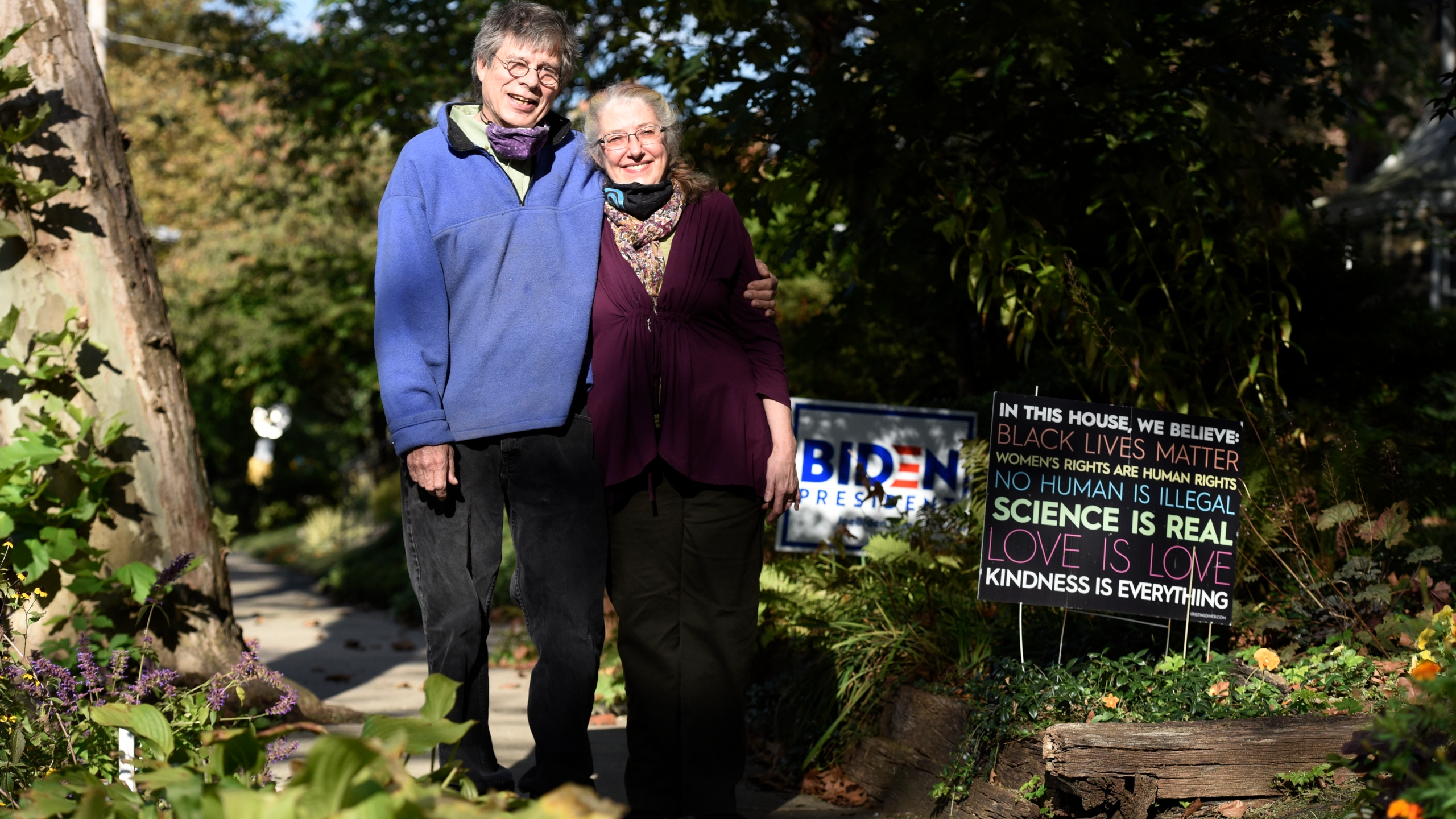 Ann Mintz, 73, and Clifford Wagner, 65, pose for a picture at their home in Philadelphia on Oct. 6, 2020. (Michael Perez / Associated Press)