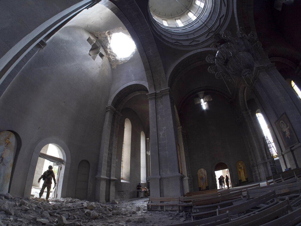 A hole made by shell in the roof of the Holy Savior Cathedral during a military conflict, in Shushi, outside Stepanakert, self-proclaimed Republic of Nagorno-Karabakh on Oct. 8, 2020. (AP Photo)