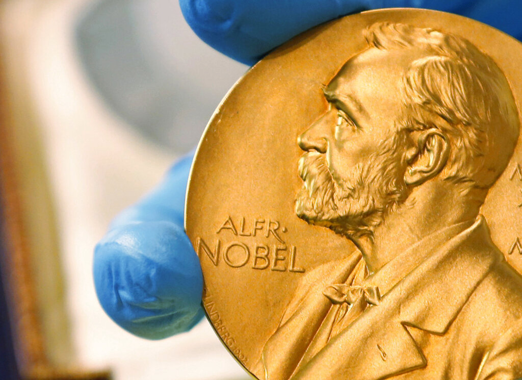 """In this April 17, 2015 file photo shows a gold Nobel Prize medal. Americans Paul R. Milgrom and Robert B. Wilson have won the Nobel Prize in economics for """"improvements to auction theory and inventions of new auction formats."""" it was announced Monday Oct. 12, 2020. (AP Photo/Fernando Vergara, File)"""