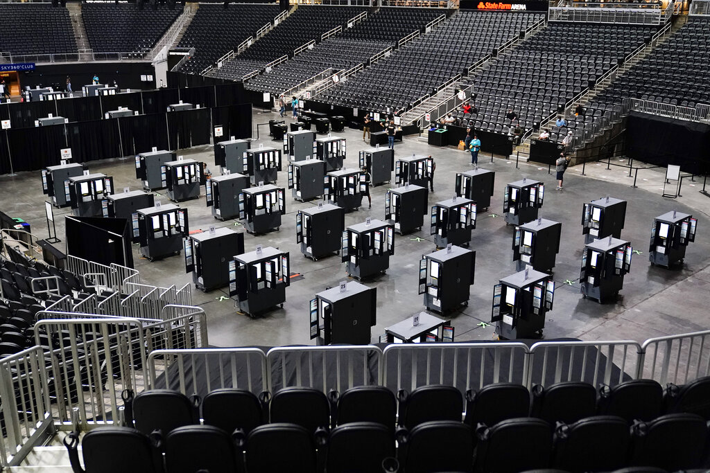 Voting machines fill the floor for early voting at the State Farm Arena on Oct. 12, 2020, in Atlanta. (AP Photo/Brynn Anderson)