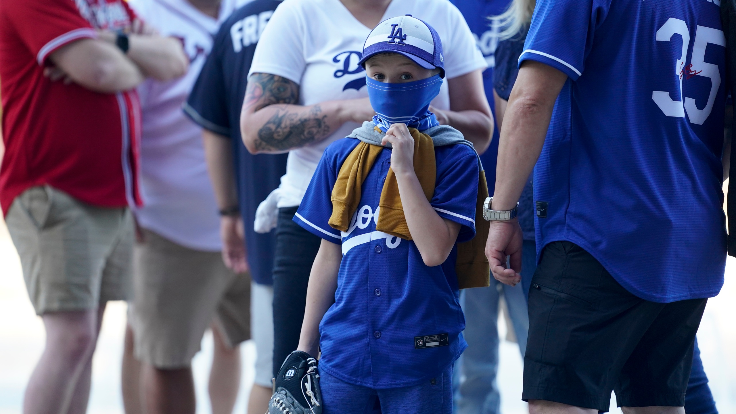 Fans arrive before Game 1 of a baseball National League Championship Series between the Los Angeles Dodgers and the Atlanta Braves on, Oct. 12, 2020, in Arlington, Texas. (AP Photo/Eric Gay)