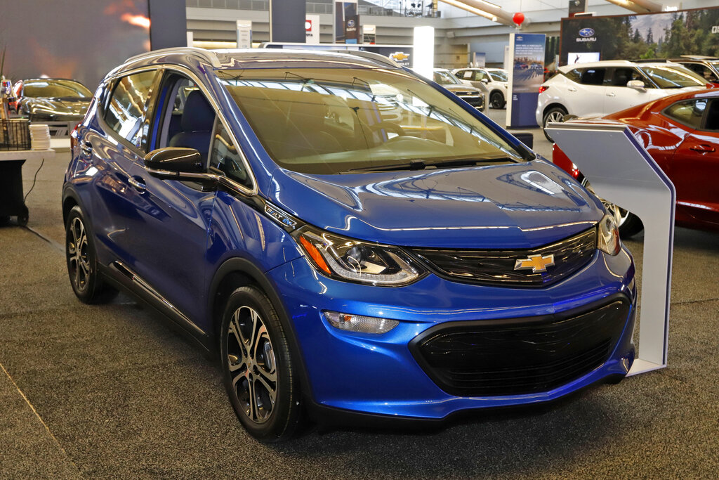 In this Feb. 13, 2020 file photo a 2020 Chevrolet Bolt EV is displayed at the 2020 Pittsburgh International Auto Show in Pittsburgh. (AP Photo/Gene J. Puskar, File)